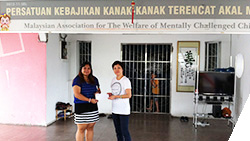 Coface Malaysia -  Country Manager Li-choo ONG presenting Cheque to welfare centre